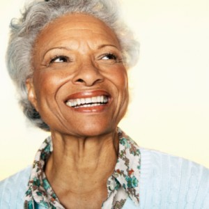 Woman smiling with dental implants from giamberardino dental care