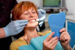 An older woman at her dental appointment.