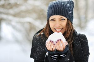Woman smiling with snow.