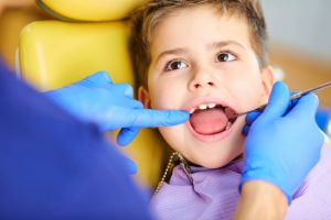 kid with dentist