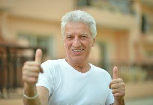 older man grey hair thumbs up