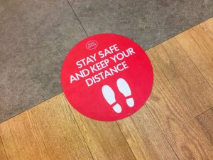 Floor sign from Medford distance reminding patients to practice social distancing