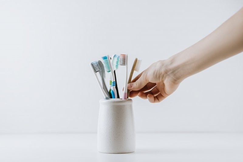 Container of toothbrushes