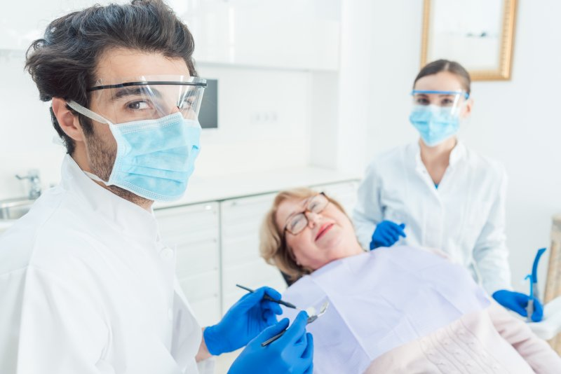 Dentists wearing face shields