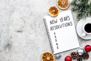 a new year's resolutions list on a notepad