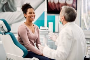 woman meets with dentist in Medford