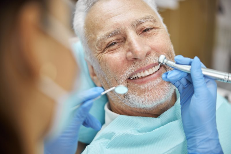 man with dentures in Medford smiling